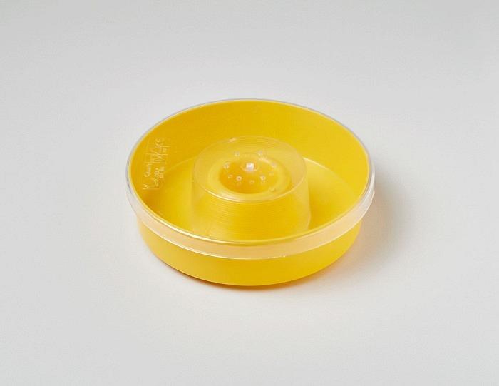 Nourrisseur jaune rond